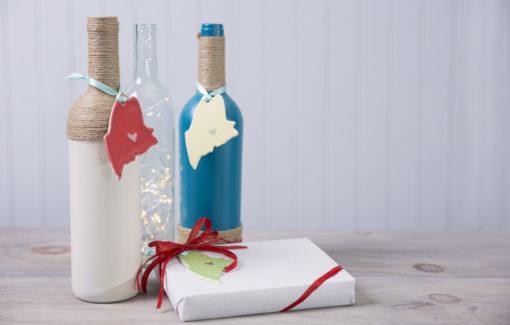 Maine Ornaments on wine bottles