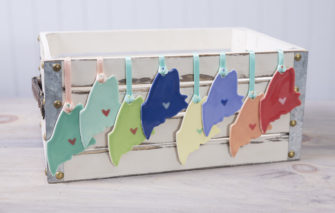 Maine Ornaments - Group on crate
